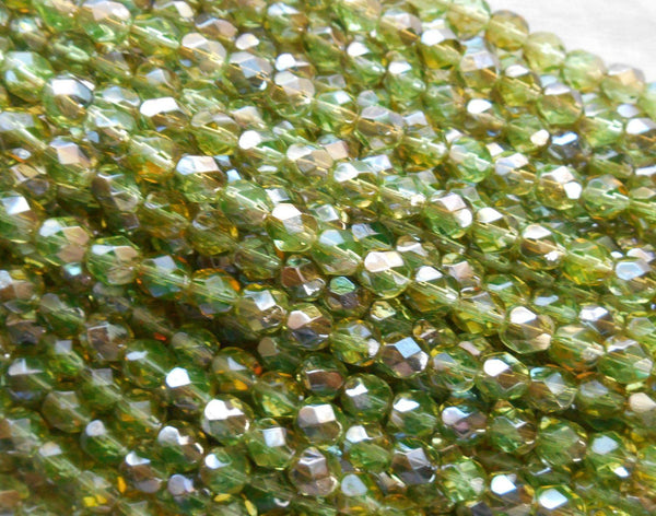 Lot of 25 6mm Czech Chrysolite Celsian Green glass, round faceted firepolished beads, C7425 - Glorious Glass Beads