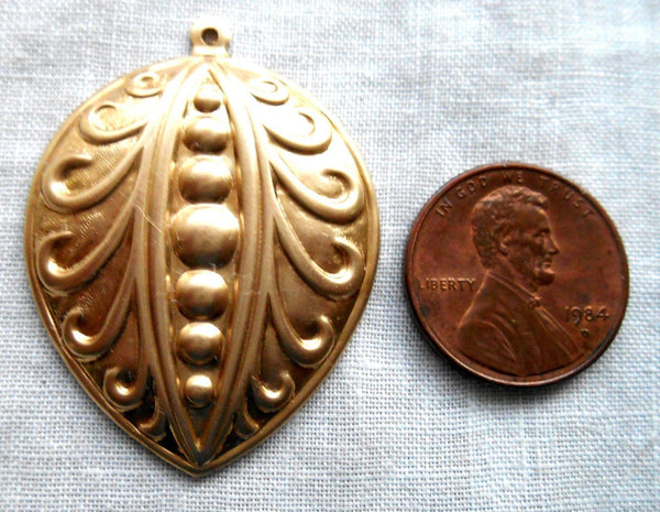 One Raw Brass Stamping, Victorian, Art Nouveau, pea pod like pendant, charm, drop, earring, 39mm x 29mm, made in the USA, C2201 - Glorious Glass Beads