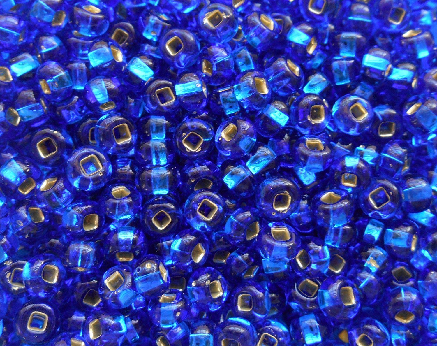 pkg of 24 grams capri blue silver lined czech 60 large glass seed beads