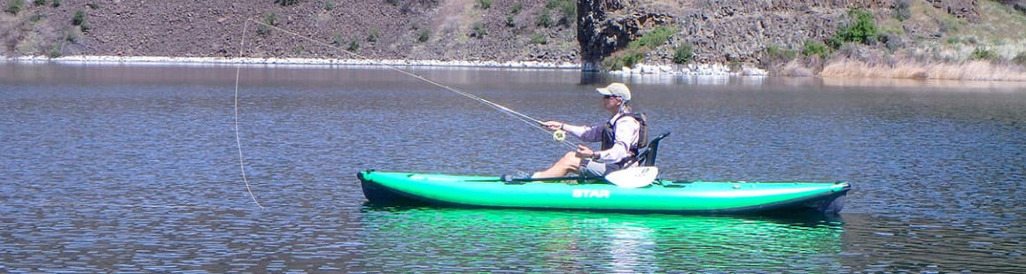 Star Pike Inflatable Fishing Kayak Review | Pike 1 Person Sit On Top Fishing Kayak being fished in the middle of the lake.
