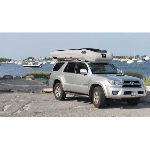 "Sea Eagle 10'6"" Sport Runabout Inflatable Boat upside down on the roof an SUV."