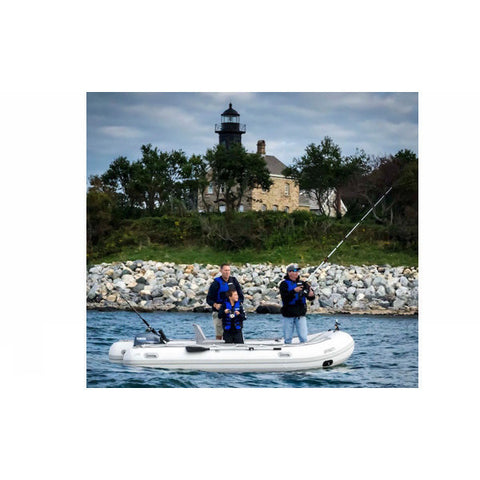 "Sea Eagle 10'6"" Sport Runabout Inflatable Boat on the lake with 2 fishermen."