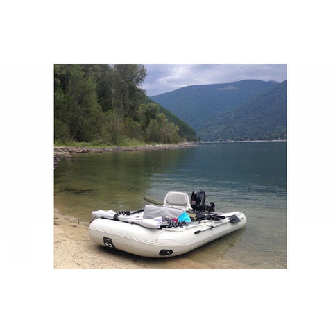"Sea Eagle 10'6"" Sport Runabout Inflatable Boat on the beach of a lake."