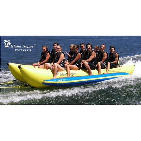 Side view of the yellow Island Hopper 10 Person Banana Boat Tube ridden by 10 adult men, splashing across the lake.