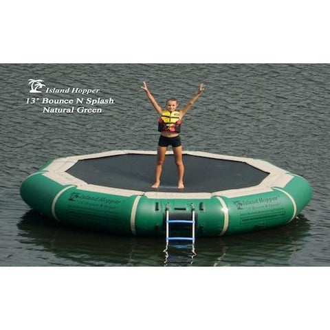 Hunter Green Island Hopper 13' Bounce N Splash Inflatable Water Bouncer in the lake with 1 kid standing on the black bouncer surface.