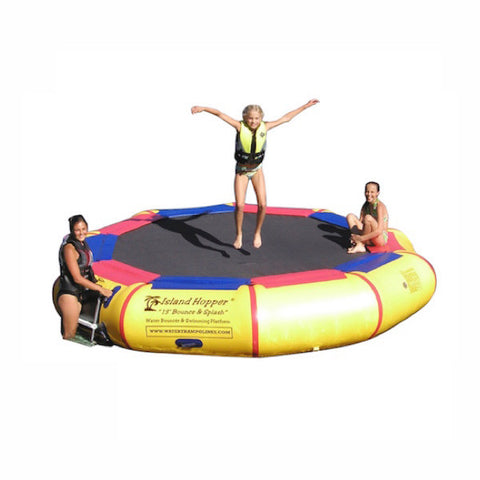 Island Hopper 13' Bounce N Splash Inflatable Water Bouncer.  Yellow inner tube with black trampoline surface and alternating red and blue thin pads around the connection to the inner tube.  3 people using the Island Hopper inflatable water bouncer