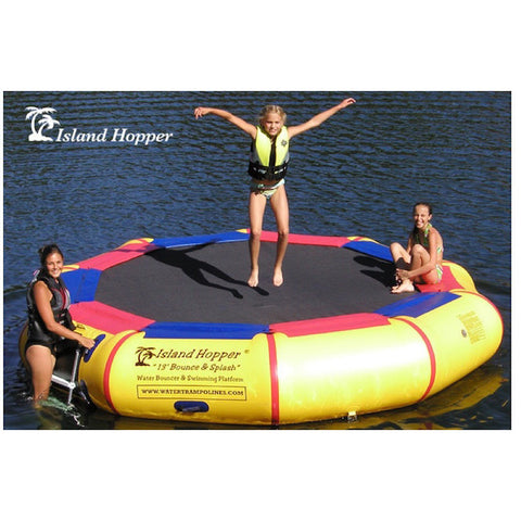 Island Hopper 13' Bounce N Splash Inflatable Water Bouncer.  Yellow inner tube with black trampoline surface and alternating red and blue thin pads around the connection to the inner tube.  3 people using the Island Hopper inflatable water bouncer on a lake, 1 bouncing, 1 on the ladder, one sitting on the thin blue and red padding next to the black bouncer surface.