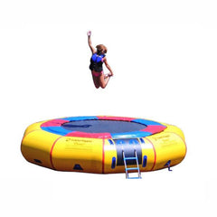 Girl jumping on the Island Hopper 15' Classic Water Trampoline on a white background.  Yellow inner tube, black trampoline surface, red and blue trim.
