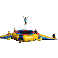 Yellow Island Hopper 15' Gator Monster Water Trampoline Water Park with blue and red trim on a white background.  4 Kids sitting on the inflatable water park and 1 kid jumping on the water trampoline.