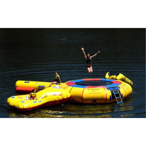 View of the Island Hopper 15' Classic Water Trampoline with several water park attachments.