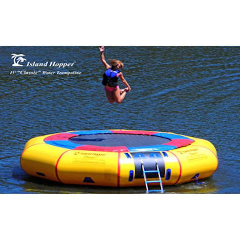 Yellow Island Hopper 15' Classic Water Trampoline on the lake with girl jumping in the air