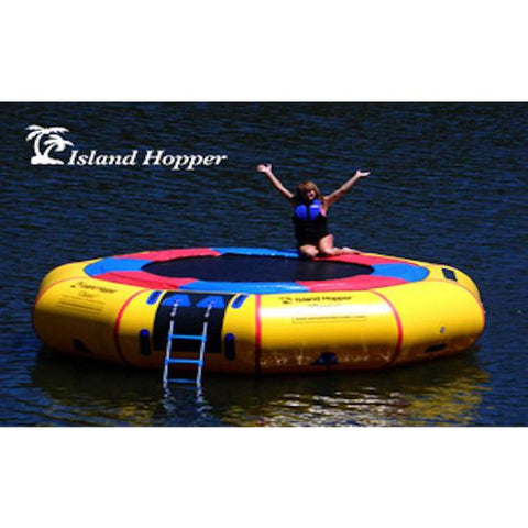 Island Hopper 15' Classic Water Trampoline in the lake with a girl sitting on the edge of the inflatable water trampoline with her hands up.