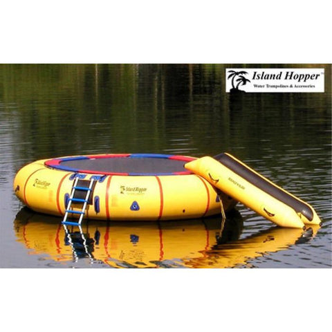Yellow Island Hopper 20 Acrobat Water Trampoline setup in the water with Bounce N Slide water attachment.