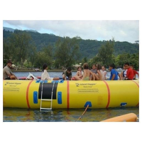 Close up view of several kids sitting on the Island Hopper 20 Acrobat Water Trampoline on the water.