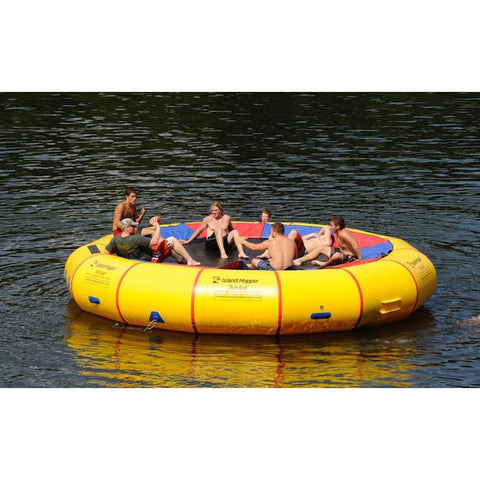 Several young boys sitting on the yellow Island Hopper 20' Acrobat Water Trampoline