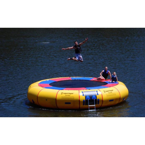 Island Hopper 20' Acrobat Water Trampoline on the water jumping on the inflatable water trampoline