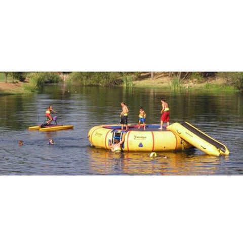 Kids playing on the Island Hopper 20ft Acrobat Water Trampoline in the lake.