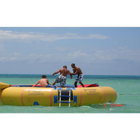 3 men playing on the yellow Island Hopper 20 Acrobat Water Trampoline in the ocean.