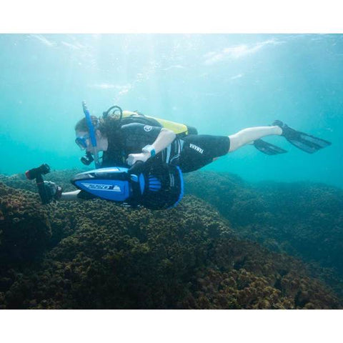 Yamaha 220Li Sea Scooter underwater sideview of the blue 220 Li Sea Scooter by Yamaha.  The man is above the Yamaha Sea Scooter and riding with the nose of the seascooter just above his body.