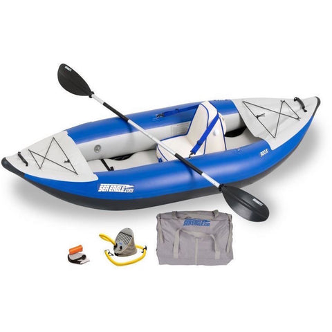 Blue and Grey Sea Eagle Explorer 300X Solo Inflatable Kayak top and side display view with the bag and pump sitting next to the Sea Eagle inflatable kayak.