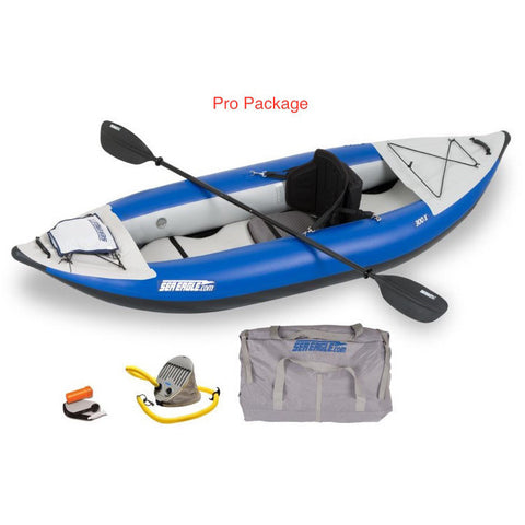 Sea Eagle Explorer 300X Solo Inflatable Kayak Pro package top and side display view with the bag and pump sitting next to the Sea Eagle inflatable kayak.