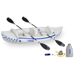 White and blue Sea Eagle 330 Sport Inflatable Kayak top view with the bag and pump sitting next to the Sea Eagle inflatable boat.