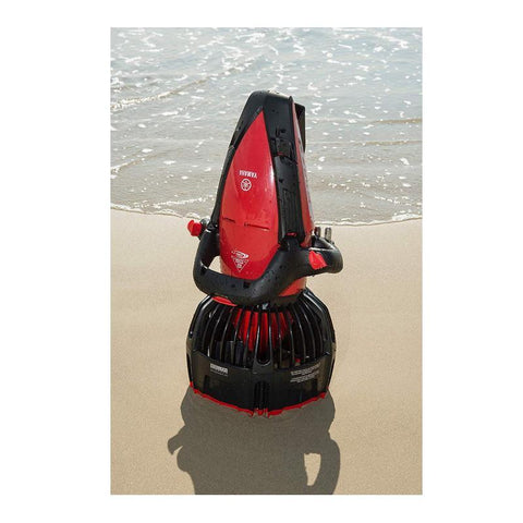 Upright view of the red and black Yamaha 350Li Sea Scooter on the beach.  Sand and water are in the picture and the Yamaha 350 Li is glimmering in the sun.