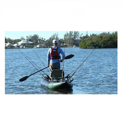 Sea Eagle 350fx Inflatable Fishing Kayak out on the water with several fishing poles set up and a paddler standing up.