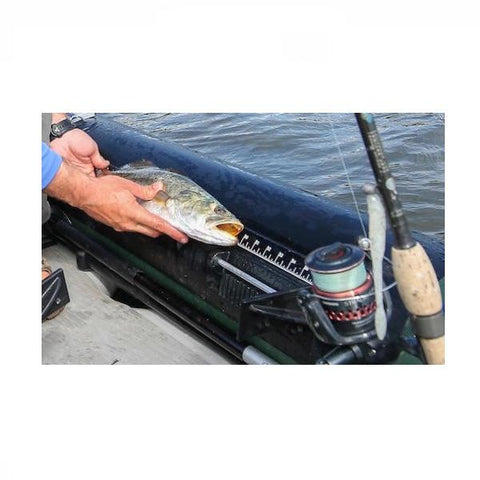 A fish being measured on the measuring tape attached to the Sea Eagle 350fx Inflatable Fishing Kayak.
