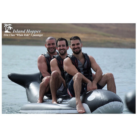 3 guys riding an Island Hopper 3 Person Whale Ride Banana Boat Tube on the lake, front view.