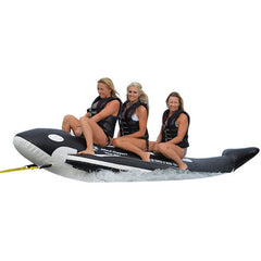 Black and White Island Hopper 3 Person Whale Ride Banana Boat Tube being ridden by 3 girls.  Image on a white background.