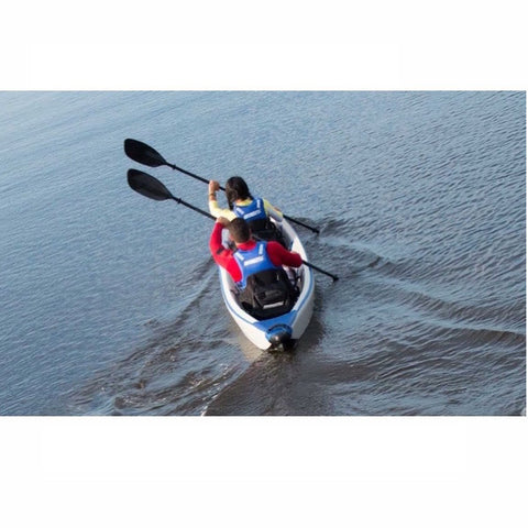 2 woman paddling a Sea Eagle RazorLite 473rl Tandem Inflatable Kayak through the water.