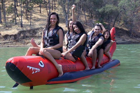 Island Hopper 6 Person Red Shark Banana Boat Tube for Sale. This beautiful red shark banana boat has 4 girls and 2 guys.