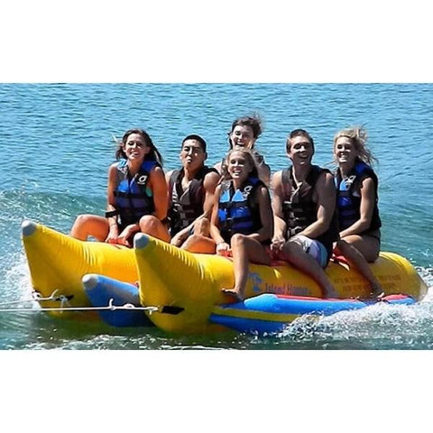 Island Hopper 6 Person Towable Banana Boat Tube front view, full of kids out on the lake. Yellow with blue trim.