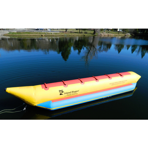 Side view of an Island Hopper 6 Man Banana Boat Tube sitting on the water.  Yellow inner tube with light blue inflatable foot rest and red seating.