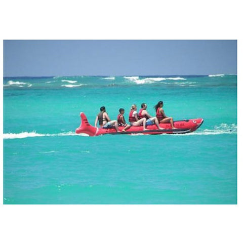 Far, side view of an Island Hopper 6 Person Red Shark Banana Boat Towable Tube on the ocean.