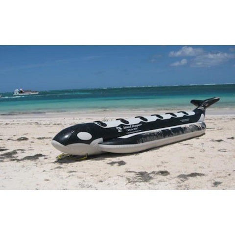Front side view of the Island Hopper Whale Ride 6 Person Banana Boat sitting on the beach.