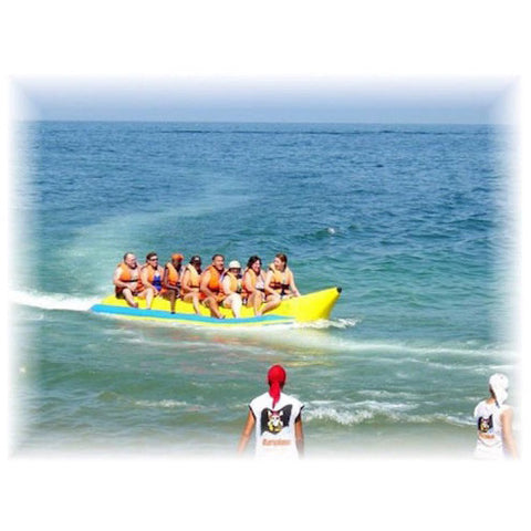 8 adults riding an Island Hopper 8 Person Towable Banana Boat Tube on the ocean.