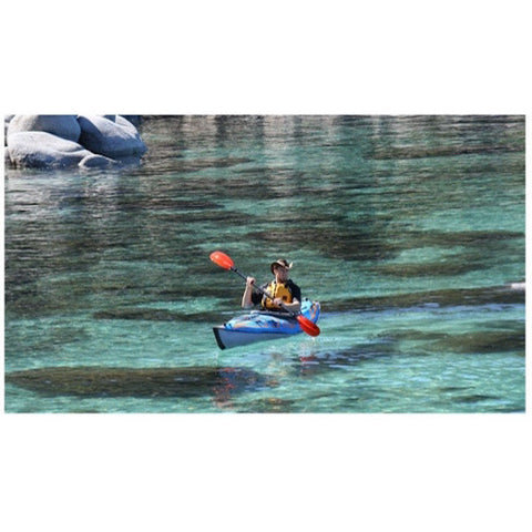 Advanced Elements AdvancedFrame Expedition Elite Solo Inflatable Kayak out on some open clear water.