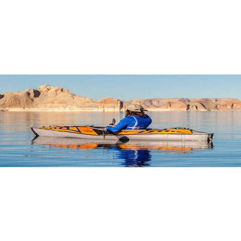 Advanced Elements AdvancedFrame Sport Inflatable Kayak side view out on the water with 1 passenger.