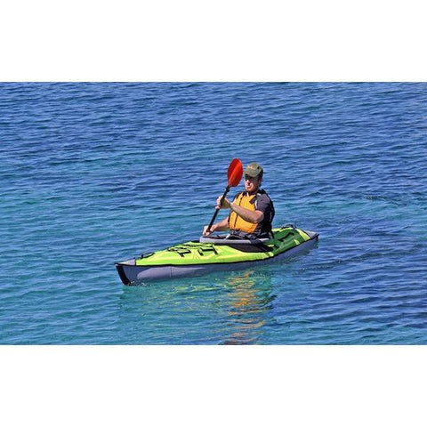 Green Advanced Elements Solo AdvancedFrame Inflatable Kayak out on the open water.