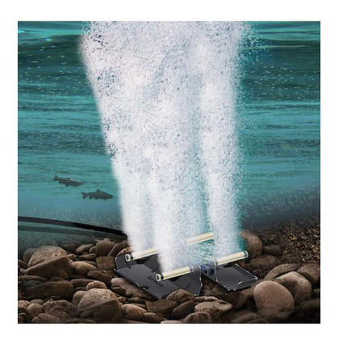 Airmax LakeSeries Aeration System is illustrated at the bottom of a lake thrusting air into the lake and there are fish swimming in the background.