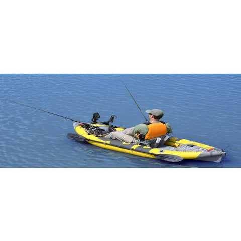 Yellow and grey Advanced Elements StraitEdge Angler 1 Person Inflatable Kayak out on the open water fishing.