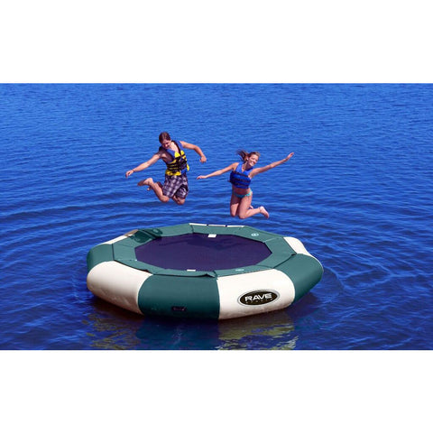 Green and Tan Rave Aqua Jump 120 Eclipse Northwoods Water Trampoline being jumped on by 2 kids on the lake.