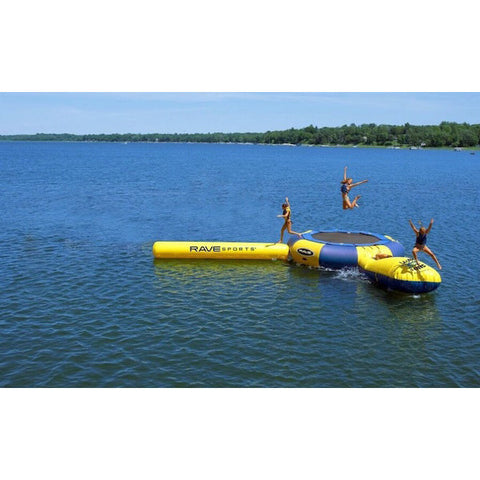 3 people playing on the yellow and blue Rave Aqua Jump Eclipse 150 Water Trampoline Water Park in the middle of a lake.