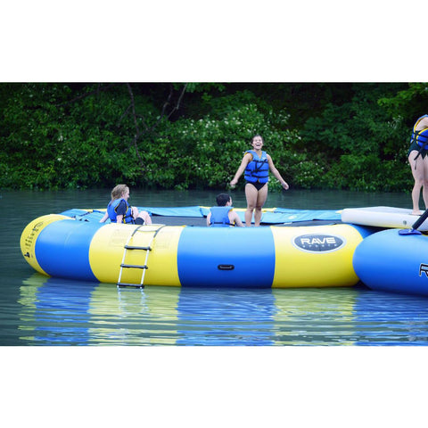 Adults and kids playing on the yellow and blue Rave Aqua Jump Eclipse 200 Water Trampoline out on the lake.  Ladder is visible on the side.