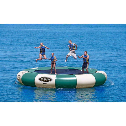 4 kids jumping on a green and tan Rave Aqua Jump Eclipse 200 Northwoods Water Trampoline