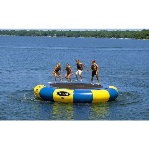 4 kids jumping on a blue and yellow Rave Aqua Jump Eclipse 200 Water Trampoline on a lake.