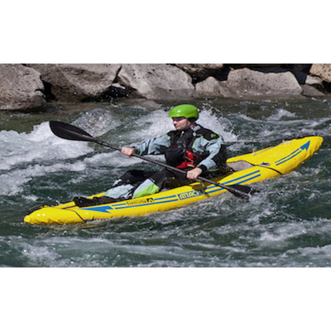 Yellow Advanced Elements Attack Whitewater 1 Person Inflatable Kayak in the water going through mild rapids.