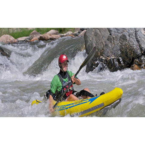 Front view of a kayaker paddling the yellow Advanced Elements Attack Whitewater 1 Person Inflatable Kayak
